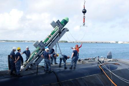 Mark 48 torpedo being loaded on fast attack nuclear submarine USS Oklahoma City (SSN-723).
