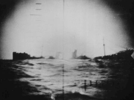 A torpedoed Japanese merchant ship sinks in the Pacific.
