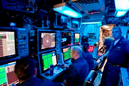 "The sonar room or ""shack"" aboard a nuclear submarine."