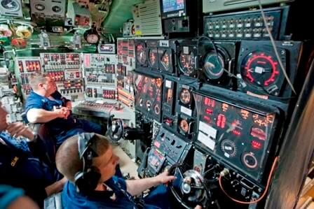 The helm/planes control  				and the periscope are part of the Control Room